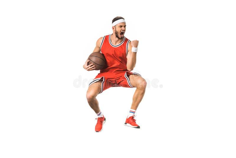 triumfera ung banhoppning för basketspelare med bollen arkivbild