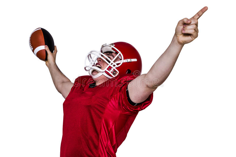 A triumph of an american football player. With black background stock images