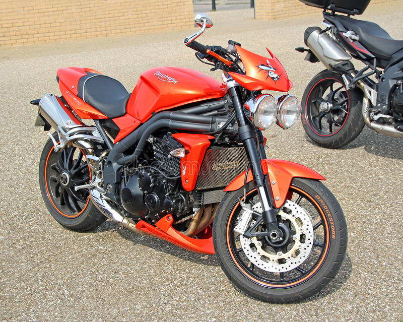 Triumph super bike. Photo of a bright orange triumph super bike on show in herne bay on 24th april 2015. photo ideal for motorcycles,super bikes,racing etc royalty free stock image