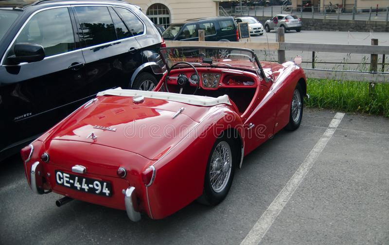 Triumph TR3 red oldtimer car  (built in 1959. GRINDELWALD, SWITZERLAND - JUNE 14, 2013: Triumph TR3 red oldtimer car  (built in 1959 stock photos
