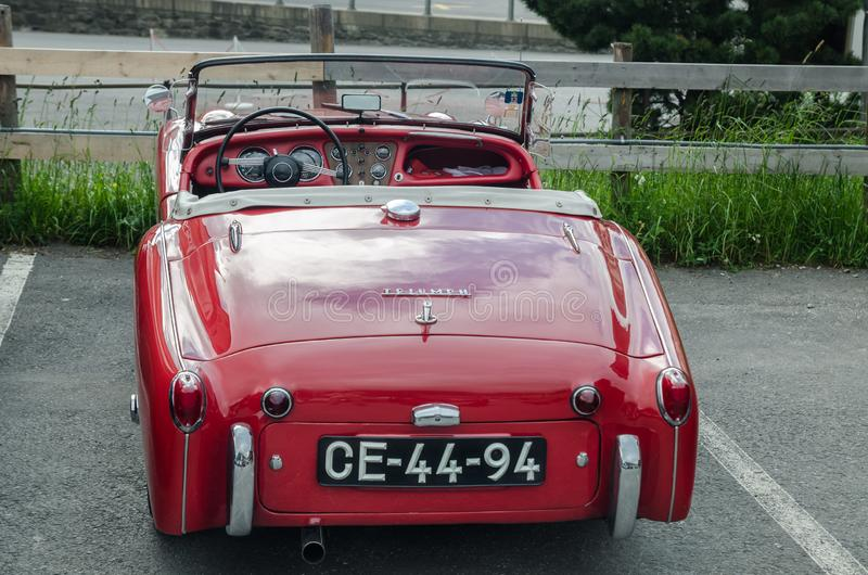 Triumph TR3 red oldtimer car  (built in 1959. GRINDELWALD, SWITZERLAND - JUNE 14, 2013: Triumph TR3 red oldtimer car  (built in 1959 stock images