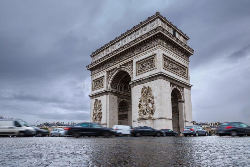 Triumphal arch. Arc de triomphe. View of Place Charles de Gaulle. Famous touristic architecture landmark in rainy day. Long expos. Ure photography. Paris. France royalty free stock photo