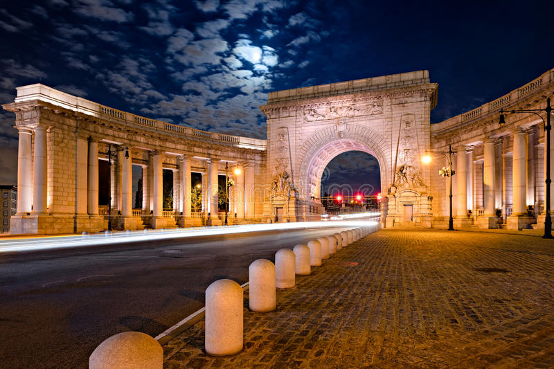 Triumphal Arch and Colonnade of Manhattan Bridge Entrance in Moonlight royalty free stock image