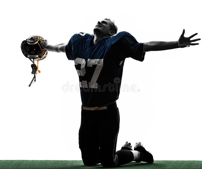 Triumphant american football player man silhouette. One caucasian american football player man triumphant in silhouette studio isolated on white background stock photography
