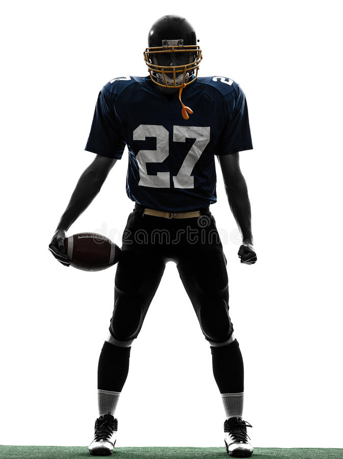 Triumphant american football player man silhouette. One caucasian american football player man triumphant in silhouette studio isolated on white background stock images
