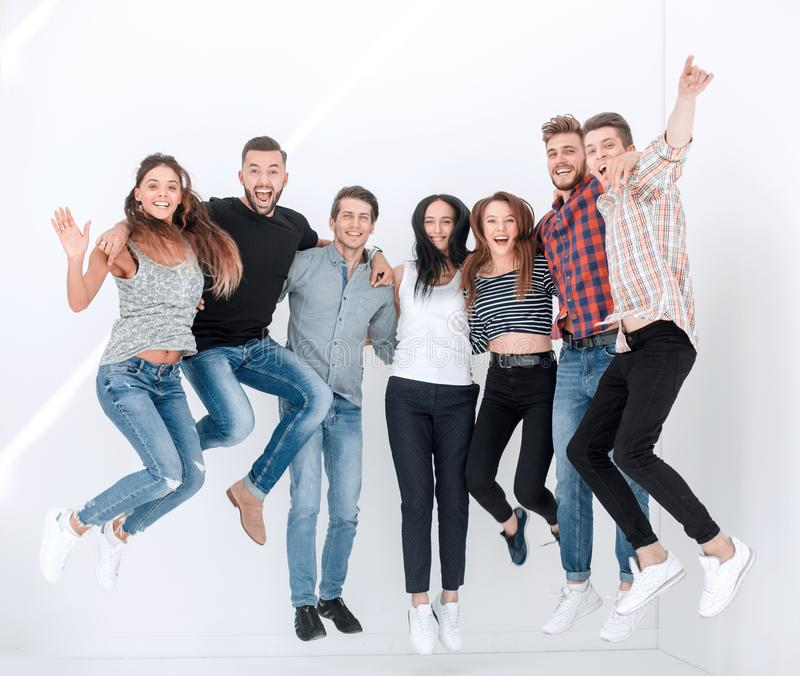 Triumphant group of young people royalty free stock images