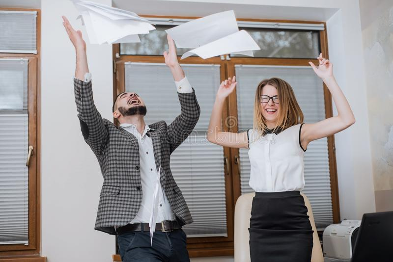 Triumphant office worker succeeded in striking a good deal. Happy businessmans. Good job stock image