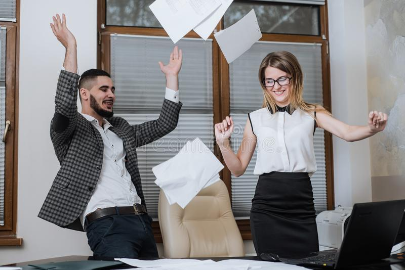Triumphant office worker succeeded in striking a good deal. Happy businessmans. Good job royalty free stock photo