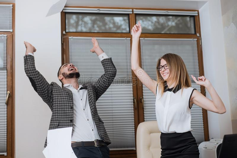 Triumphant office worker succeeded in striking a good deal. Happy businessmans. Good job stock photos