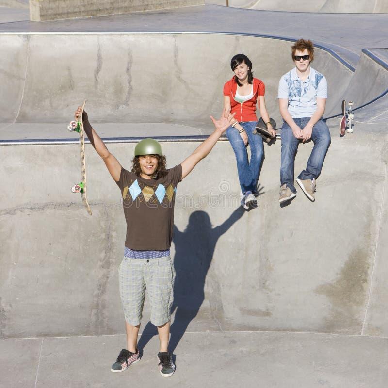 Triumphant Skateboarder Stock Image