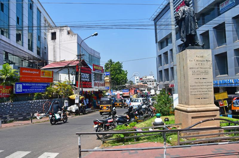 Trivandrum Thiruvananthapuram, state Kerala, India, March, 12, 2019. Busy street in the city center, monument to Rajan sir T. Ma. Trivandrum Thiruvananthapuram stock image