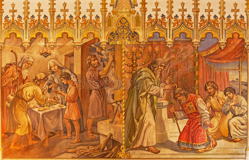 Trnava - The fresco of the scenes Moses and Aron, and Israelites at the Pesach supper at the Lord's Passover. TRNAVA, SLOVAKIA - OCTOBER 14, 2014: The fresco of royalty free stock images