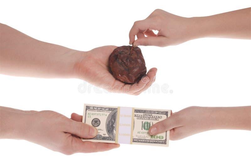 Troca desigual Dinheiro para uma mercadoria má fotos de stock royalty free