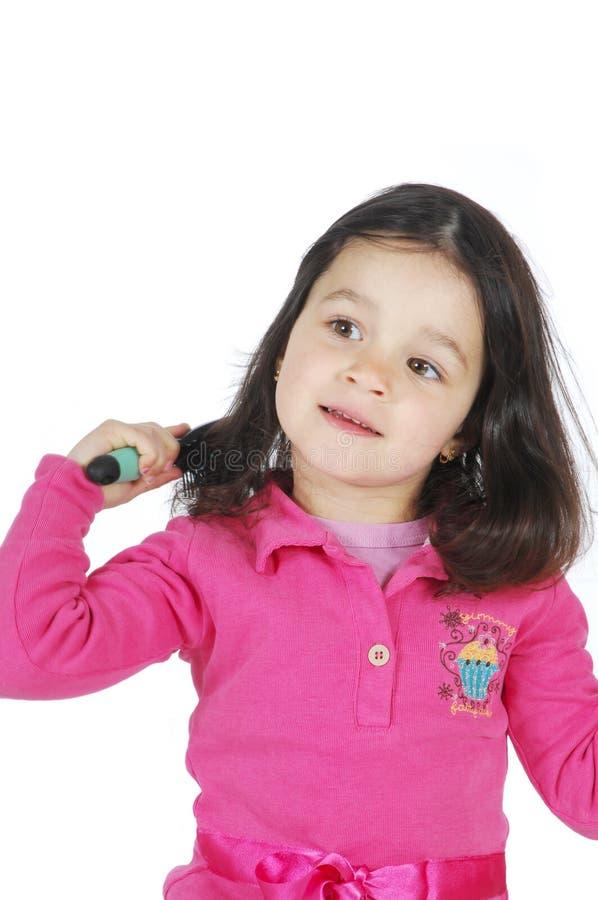 trochę dziewczyna szczotkarski śliczny włosy zdjęcia stock
