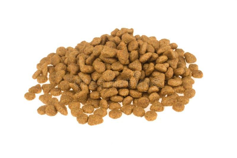 Trockenfutter für die Hunde oder Katzen lokalisiert im weißen Hintergrund Haustier care lizenzfreie stockbilder