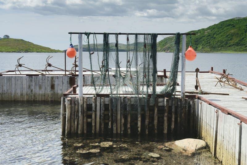 Trocknende Fischernetze, rote Bucht, Labrador lizenzfreies stockbild