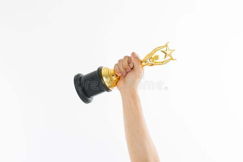 Troféu da concessão para a realização do vencedor fotos de stock royalty free
