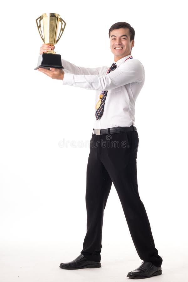 Troféu da concessão para a realização do vencedor imagens de stock royalty free