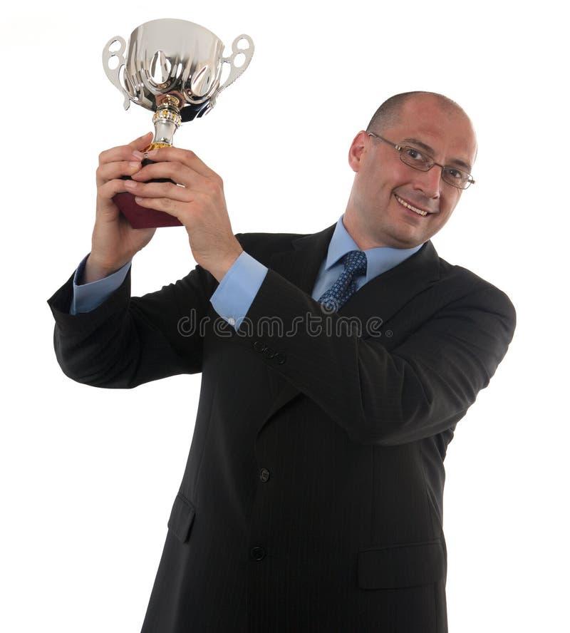Troféu da terra arrendada do homem de negócios imagens de stock royalty free