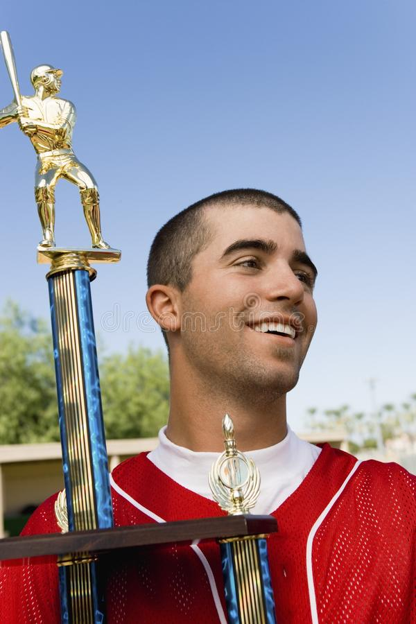 Troféu da terra arrendada do jogador de beisebol fotografia de stock royalty free