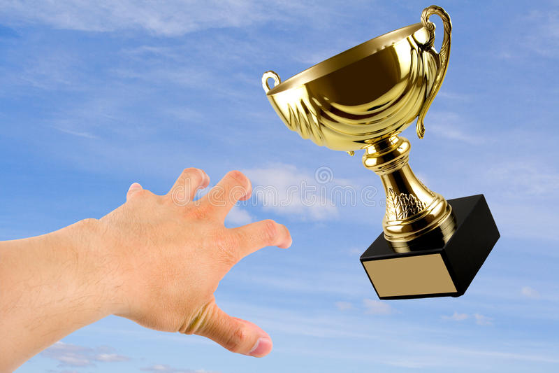 Troféu de vencimento imagem de stock