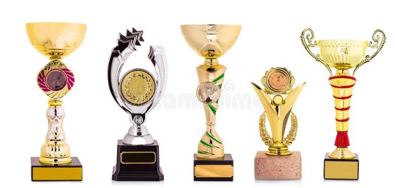 Trofeo dorato isolato su fondo bianco immagini stock