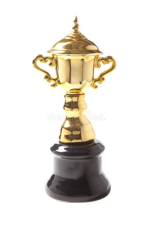 Trofeo dorato isolato su fondo bianco Premi di conquista fotografia stock libera da diritti