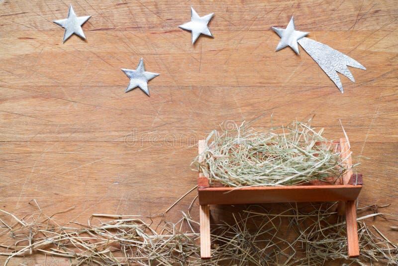 Trog en ster van Bethlehem van achtergrond abstracykerstmis geboorte van Christusscène op houten raad royalty-vrije stock afbeelding