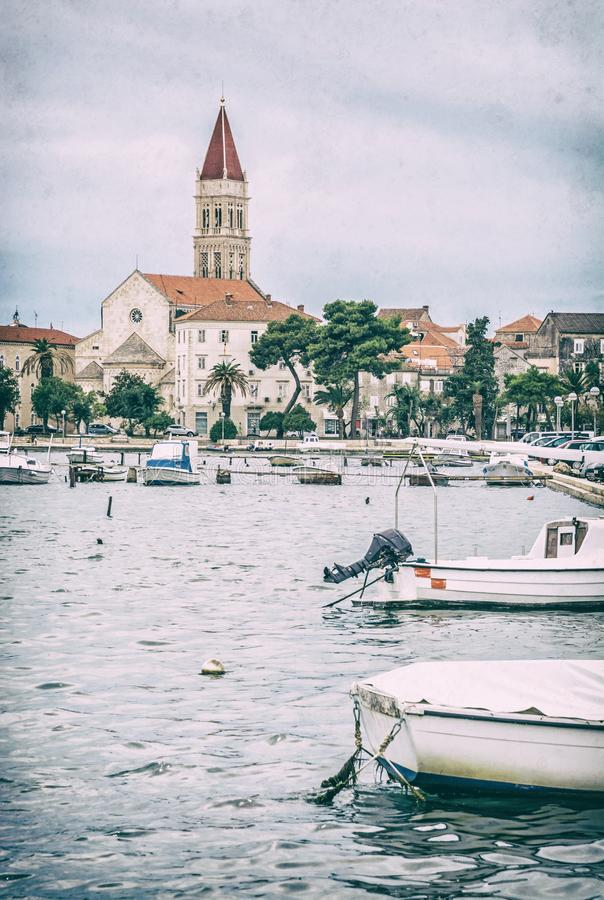 Trogir with Cathedral of St. Lawrence, analog filter. Old town Trogir with Cathedral of St. Lawrence and harbor with boats, Croatia. Travel destination. Vertical stock photos