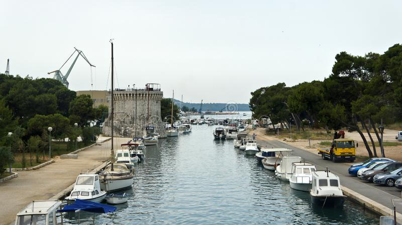 Trogir, Croatia - 07 25 2015 - View of St. Mark s Fortress in old town, channel with boats, sunny day royalty free stock photo