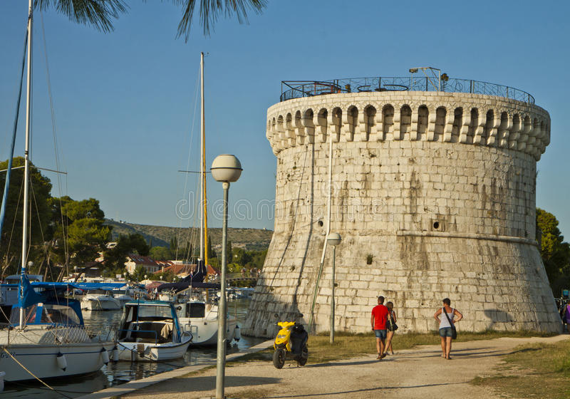 Trogir, Sr. Mark tower. TROGIR, CROATIA - St. Mark tower, round shaped fort, was built around 1400 on a canal border to defend the town from Turk attacks stock images