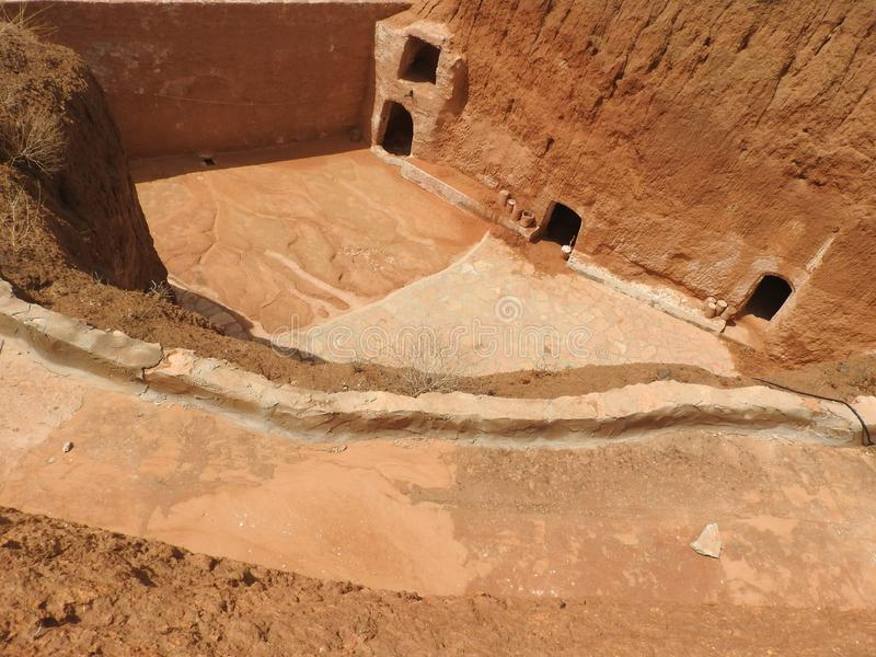 Troglodyte homes and underground caves of the Berbers in Sidi Driss, Matmata, Tunisia, Africa, on a clear day.  stock photo