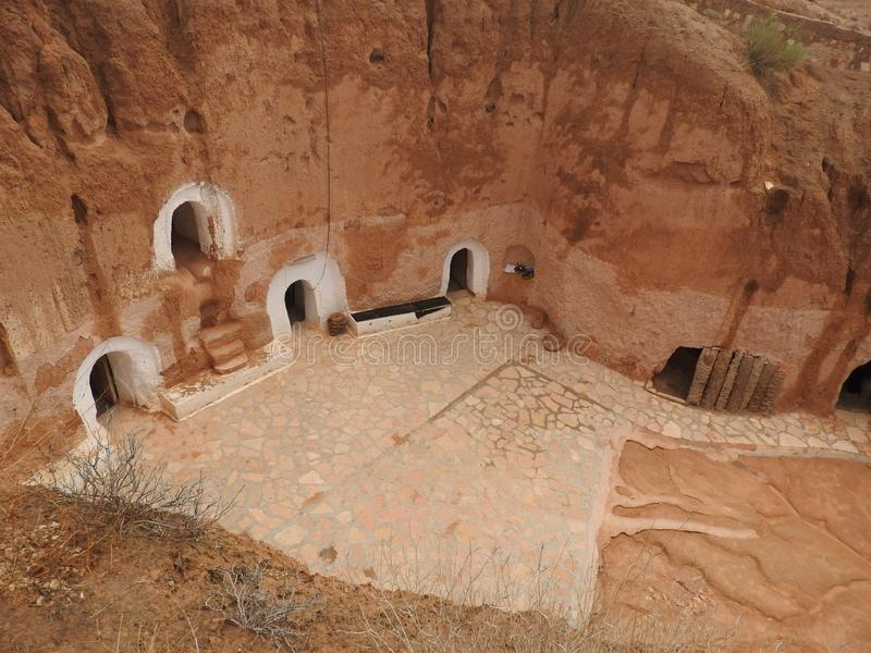 Troglodyte homes and underground caves of the Berbers in Sidi Driss, Matmata, Tunisia, Africa, on a clear day.  royalty free stock images