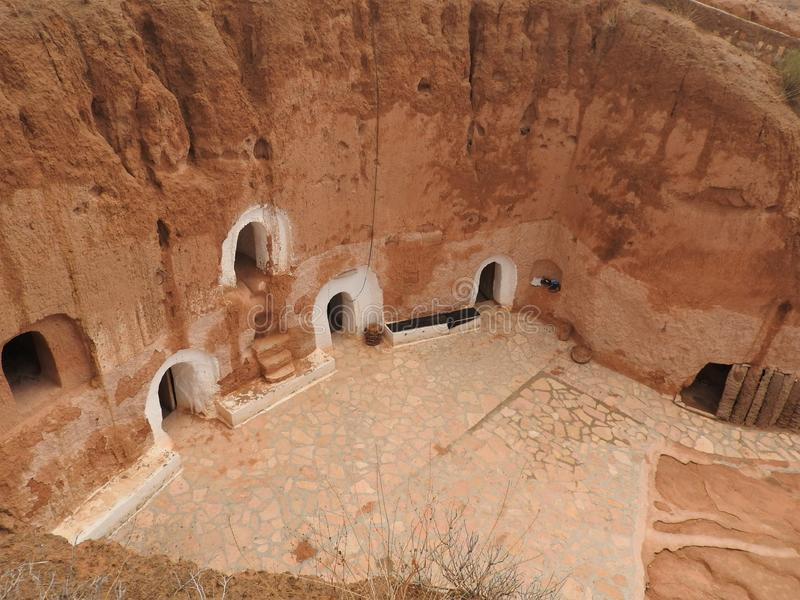 Troglodyte homes and underground caves of the Berbers in Sidi Driss, Matmata, Tunisia, Africa, on a clear day.  stock photos