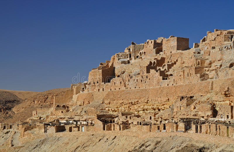 Troglodytic village in the desert. Ruins of a troglodytic village, desert stone, eastern Sahara, Chenini village, southern Tunisia stock photos