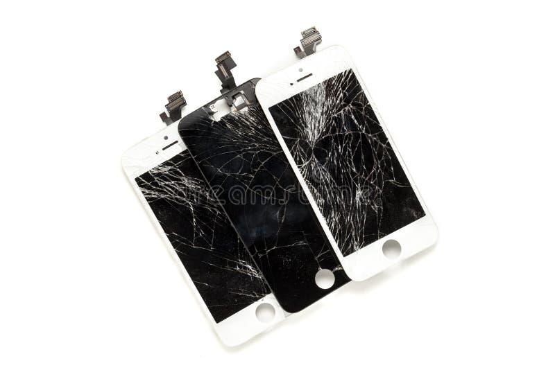 Trois affichages cassés de téléphone portable images stock