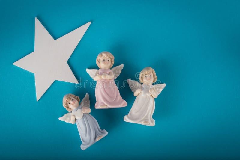Trois anges gardien et grande étoile blanche images libres de droits