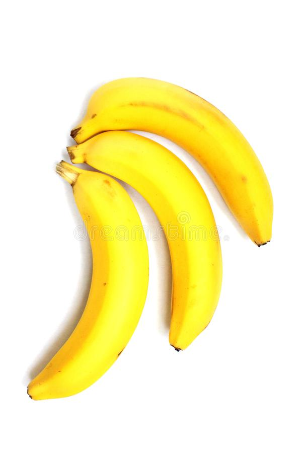 Trois bananes d'isolement à un arrière-plan blanc photos libres de droits