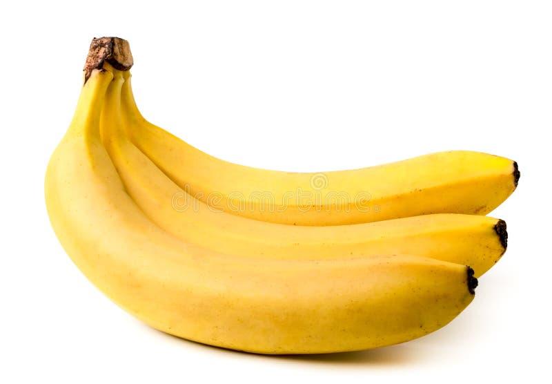 Trois bananes mûres en plan rapproché sur un fond blanc image libre de droits