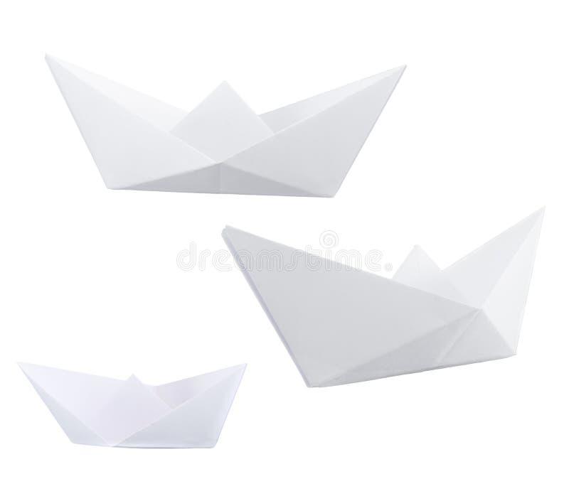 Trois bateaux de papier d'isolement au-dessus du blanc photo stock