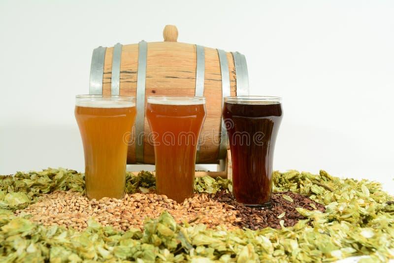 Trois bières colorées différentes photographie stock