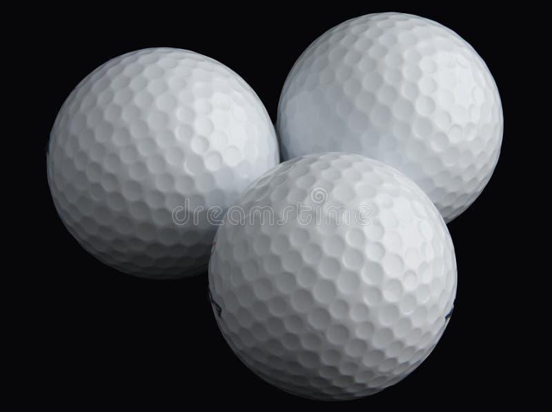 Trois billes de golf image libre de droits