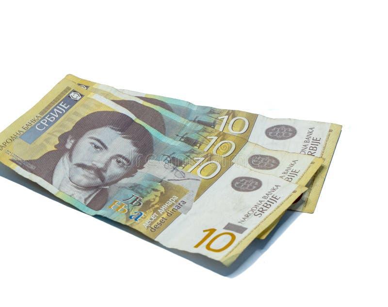 Trois billets de banque en valeur 10 dinars serbes avec un portrait d'un linguiste Vuk Karadzic d'isolement sur un fond blanc photos stock