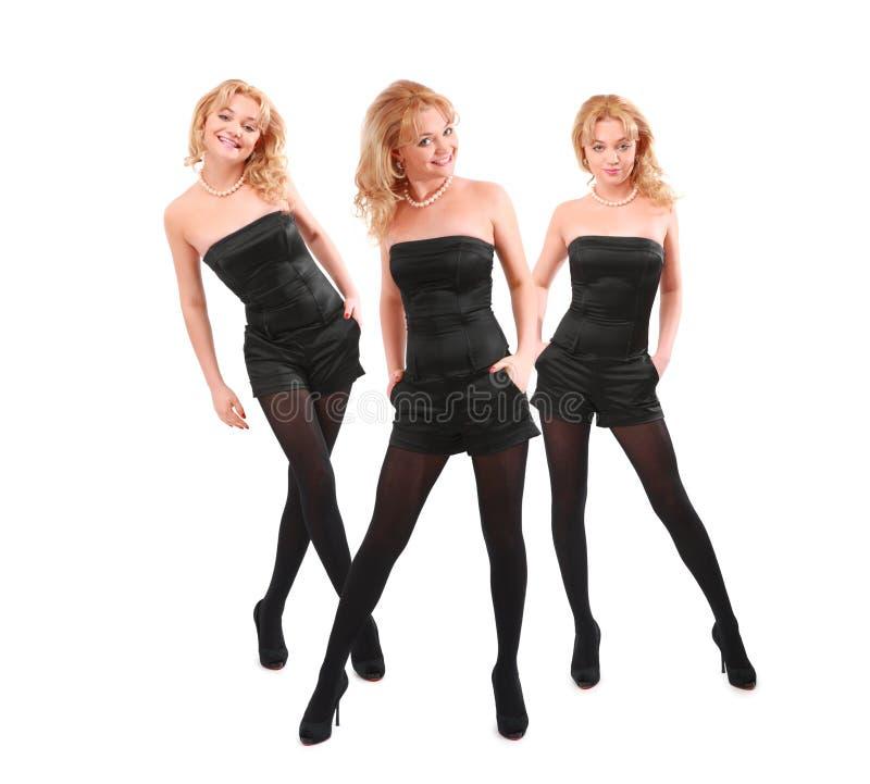 Trois blondes de sourire dans le noir, collage images stock