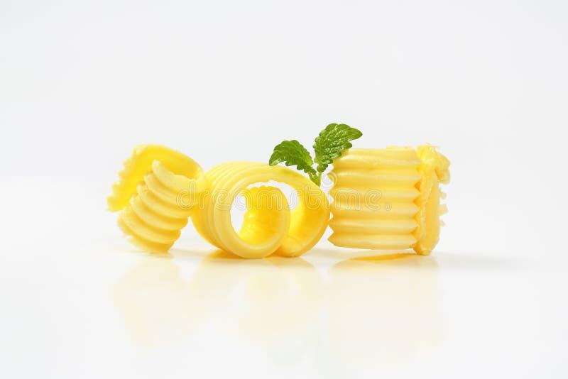 Trois boucles de beurre images libres de droits