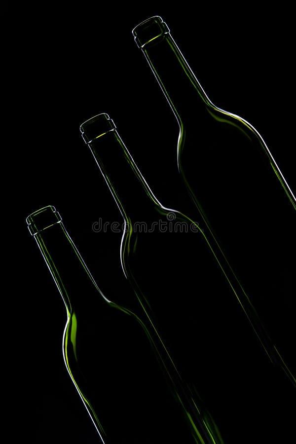 Trois bouteilles vertes vides photographie stock libre de droits