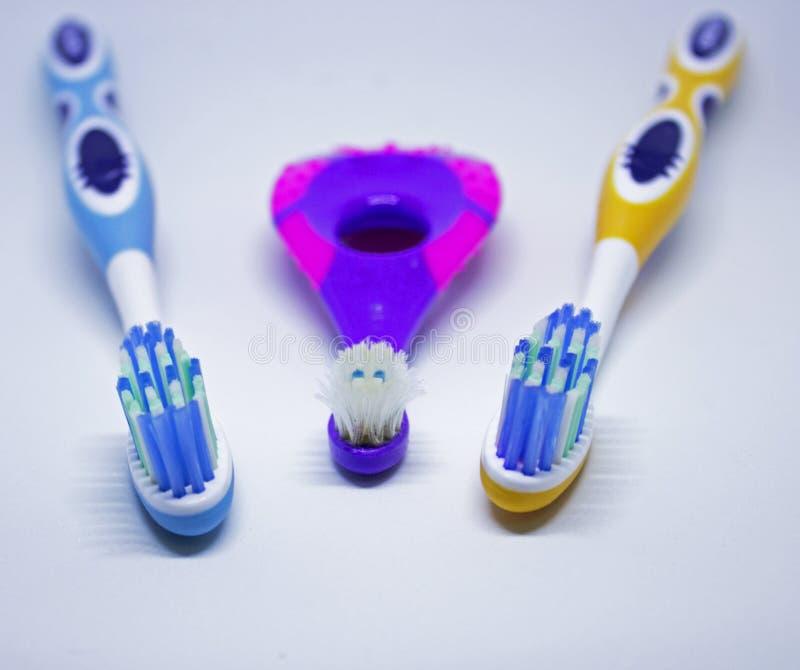 Trois brosses à dents photographie stock