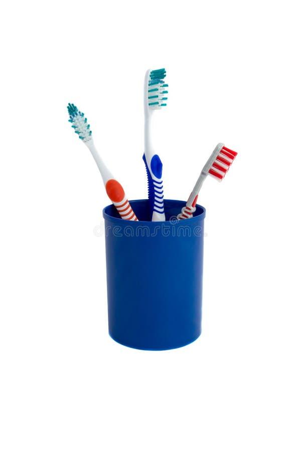 Trois brosses à dents images stock