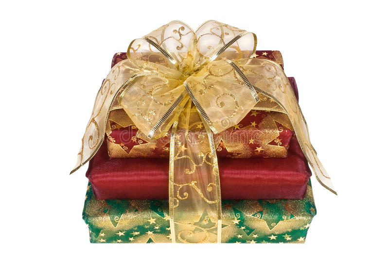 Trois cadres de cadeau enveloppés avec la bande et la proue d'or image libre de droits