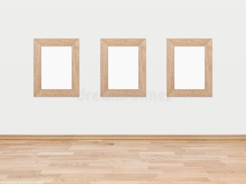 Cadres en bois vides sur un mur blanc photographie stock libre de droits